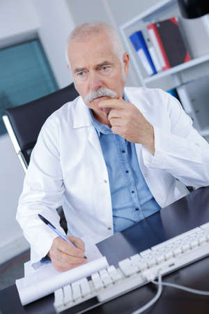 pensive senior doctor Stock Photo