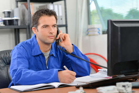 Builder making a call Stock Photo