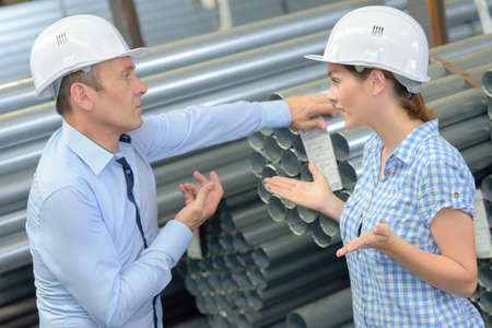 disorganize: two forepersons in disagreement Stock Photo