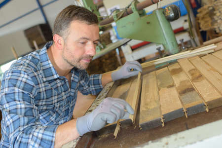 tongue and groove: Carpenter aligning planks of wood