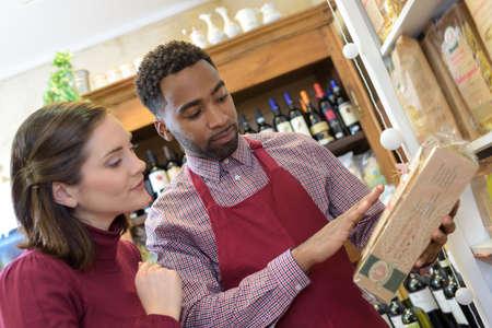 shop assistant: Shop assistant advising customer