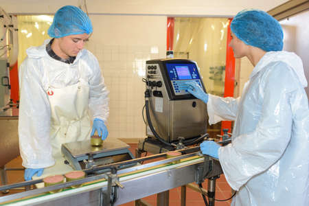 Factory workers setting up production line