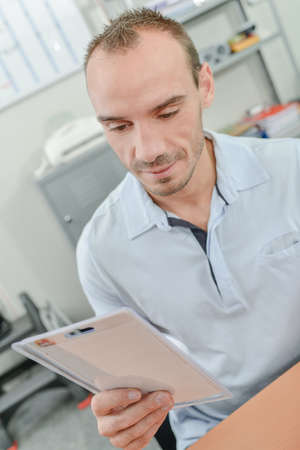 Man holding a smoke alarm Stock Photo