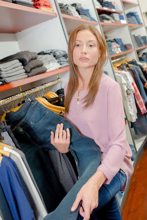 shop assistant: Shop assistant stacking shelves