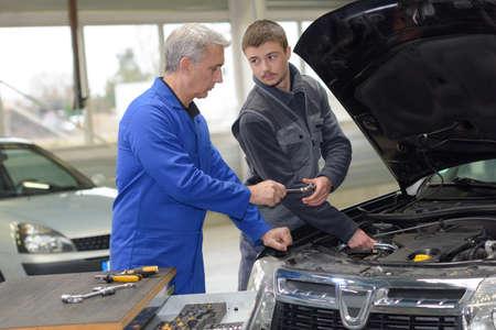proprietor: trainee mechanic at work Stock Photo