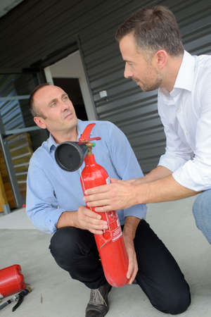fire extinguishers: Man learning about fire extinguishers Stock Photo