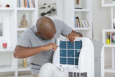 unscrewing: unscrewing an appliance