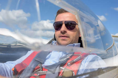 Man in solo aircraft Stock Photo