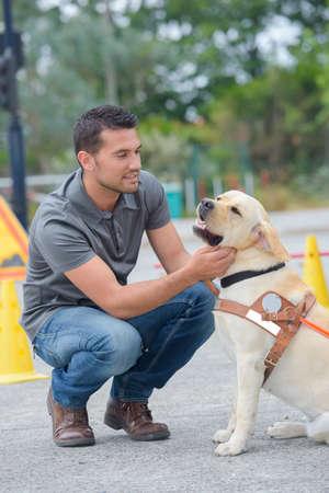 Man petting dog Stock Photo