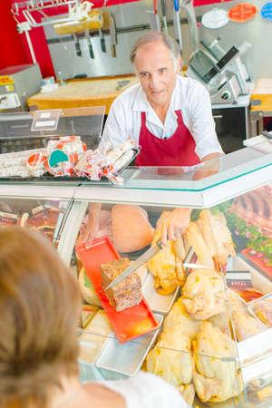 Downward view of butcher serving customer