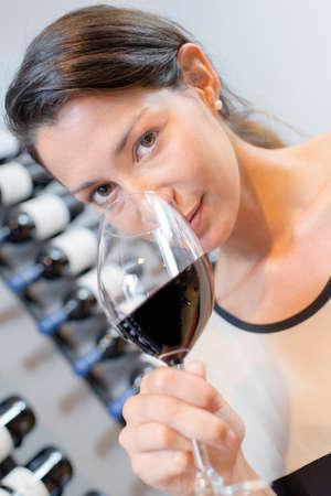 Woman smelling wine bouquet