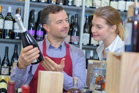 merchant: Wine merchant advising customer