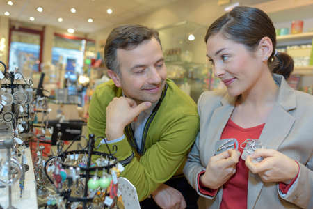 courtship: lovers choosing jewellery at the mall Stock Photo