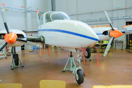 fixed wing aircraft: Aircraft parked in hangar
