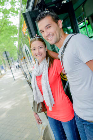 getting: Couple getting off a bus