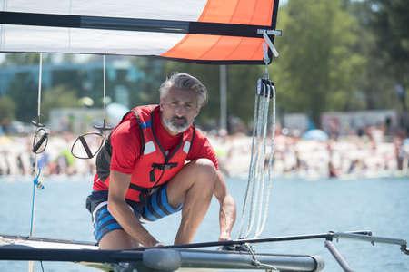 lifevest: professional waterman training on lake with catamaran