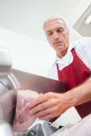 butcher slicing ham Stock Photo