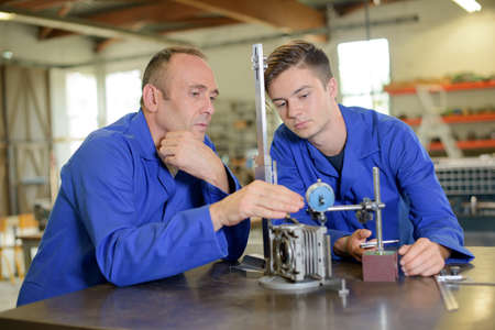 instructing: Supervisor instructing junior engineer Stock Photo