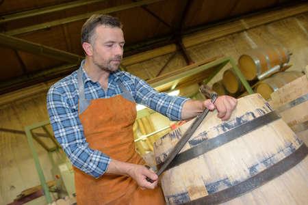 cooper: Cooper working on barrel