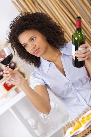 discreto: young woman tasting wine in cellar