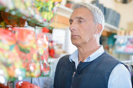morose: morose man in shop Stock Photo