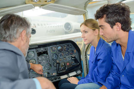 piloting: Young adults in aircraft cockpit Stock Photo