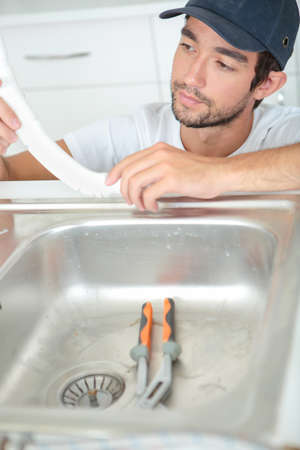 watertight: plumber in the kitchen