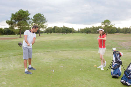 woman golf: Man and woman playing golf