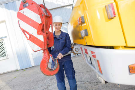 winch: Woman holding cranes winch