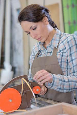 Woman using glass cutter