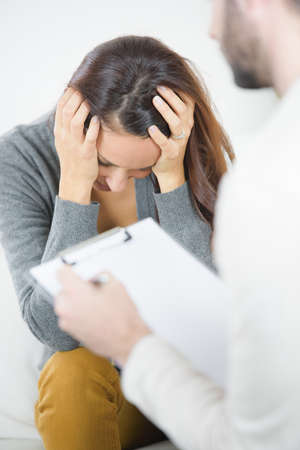 psychotherapy: psychotherapy of sad and depressed couple Stock Photo