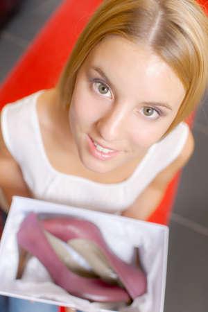 shoe box: Woman holding a shoe box Stock Photo