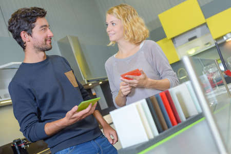 disparity: Couple holding color samples