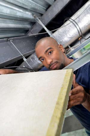 aeration: man installing ceiling