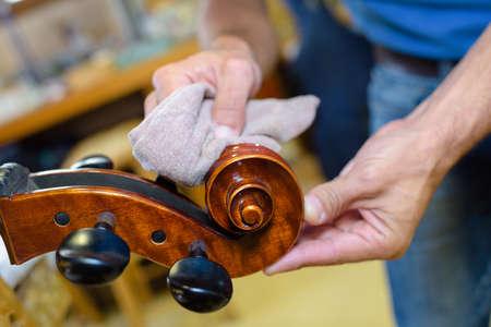 Man polishing musical instrument