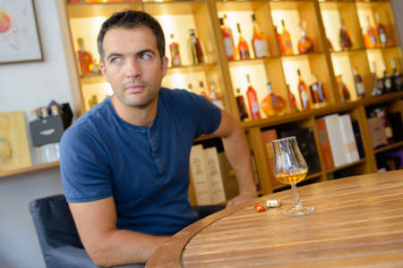 moderation: man drinking beverage alone