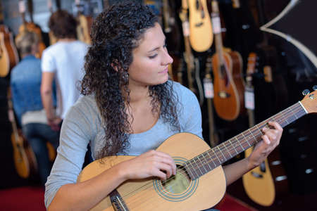 Lady playing accoustic guitar