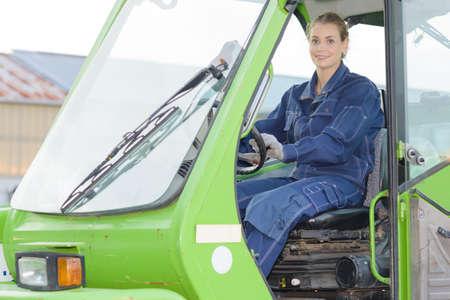 woman operating crane
