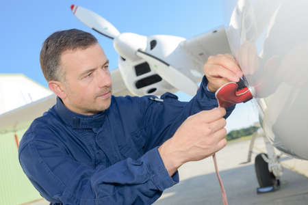 engineer filling small plane with furl