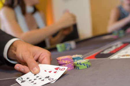 nines: Closeup of cards on gambling table Stock Photo