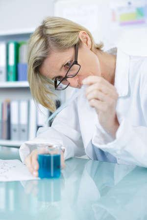 chemist: cheerful pharmacist chemist woman