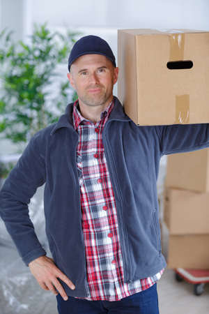 removal van: mover carrying box Stock Photo