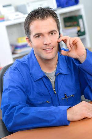 businessman phone: Artisan making a call