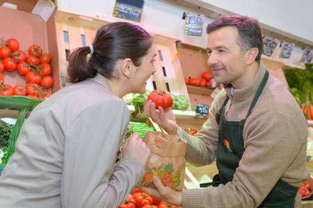 handing the tomato