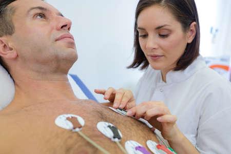 attaching: nurse attaching a body monitor