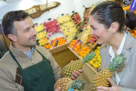 buying fresh pineapple Stock Photo