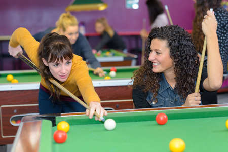 billiards halls: Women playing pool
