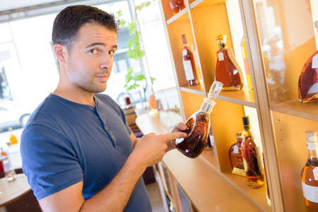 refinement: young handsome man excited about great vintage alcohol Stock Photo
