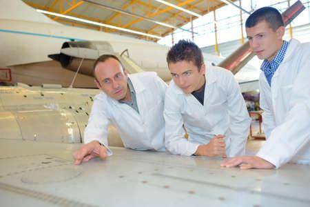 aerospace: aerospace engineers studying the blueprint