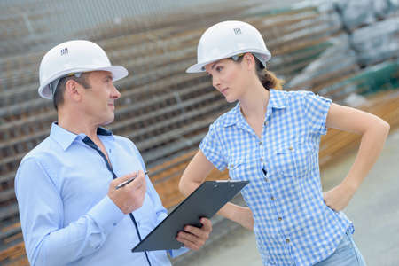 audacious: Man and woman in discussion, wearing hardhats